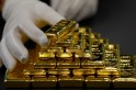 Gold prices fall as investors turn to dollar for safety amid US-China trade tensions