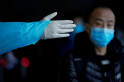 Coronavirus outbreak: Death toll hits 2,000 in China, cases fall for second day