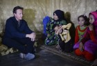 Prime Minister David Cameron visits a Syrian refugee settlement camp in the Bekaa Valley in Lebanon, September 14, 2015.