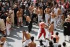 Men participate in self flagellation during the Shi'ite Muharram procession in Peshawar, Pakistan.