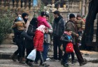 People carry their belongings as they flee deeper into the remaining rebel-held areas of Aleppo, Syria.