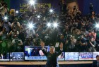 Moon Jae-in gestures to his party members as they watch a television report on a presidential election exit poll in Seoul, South Korea.