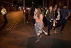 Concert goers react after fleeing the Manchester Arena in northern England where U.S. singer Ariana Grande had been performing in Manchester.