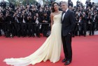 """George Clooney and Amal pose on the red carpet for the screening of the film """"Money Monster"""" out of competition at the 69th Cannes Film Festival in Cannes."""
