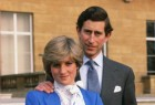 Lady Diana Spencer (later to become Princess of Wales) reveals her sapphire and diamond engagement ring while she and Prince Charles, Prince of Wales pose for photographs in the grounds of Buckingham Palace following the announcement of their engagement.