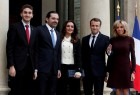 French President Emmanuel Macron and his wife Brigitte Macron, Saad al-Hariri, who announced his resignation as Lebanon's prime minister while on a visit to Saudi Arabia, his wife Lara and their son Houssam are pictured at the Elysee Palace in Paris, France, November 18, 2017.