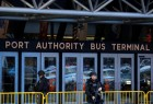 Police officers stand guard outside the New York Port Authority Bus Terminal.