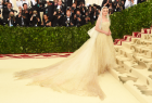 "Dozens of celebrities walked the red carpet at the 2018 Met Gala at New York City's Metropolitan Museum of Art. With its theme of ""Heavenly Bodies: Fashion and the Catholic Imagination,"" some stars looked absolutely ethereal while others bordered on demonic. The Met Gala kicked off with red carpet arrivals at 5:45 p.m. ET. Stars who attended the exhibit in the past were names like Gigi and Bella Hadid, Kim Kardashian, Kylie and Kendall Jenner, Beyoncé, Blake Lively, Sarah Jessica Parker, Selena Gomez and Nicki Minaj. Dozens of celebrities walked the red carpet at the 2018 Met Gala at New York City's Metropolitan Museum of Art. With its theme of ""Heavenly Bodies: Fashion and the Catholic Imagination,"" some stars looked absolutely ethereal while others bordered on demonic. The Met Gala kicked off with red carpet arrivals at 5:45 p.m. ET. Stars who attended the exhibit in the past were names like Gigi and Bella Hadid, Kim Kardashian, Kylie and Kendall Jenner, Beyoncé, Blake Lively, Sarah Jessica Parker, Selena Gomez and Nicki Minaj."