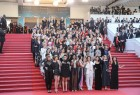 Dozens of women film stars have held a protest at the Cannes film festival against gender-based discrimination in the industry. Cate Blanchett, Kristen Stewart and Jane Fonda were among those taking part in the red-carpet demonstration. The prestigious Cannes festival has come under criticism for failing to showcase more films by women directors. The protest comes after a period of turmoil in the industry following allegations of sexual harassment. This is the first Cannes festival since allegations of sexual abuse were first made against producer Harvey Weinstein last year. He has always denied engaging in non-consensual sex. The actresses and film-makers linked arms to stroll along the red carpet. Cate Blanchett spoke of the film industry's gender inequalities.