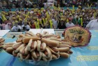 Defending champion Joey Chestnut broke his own world record at 2018 Nathan's Famous Hot Dog Eating Contest with a new hot-dog eating record by eating 74 hot dogs in 10 minutes! On the women's side, Miki Sudo brought home the title for the fifth time in a row, devouring 37 hot dogs.