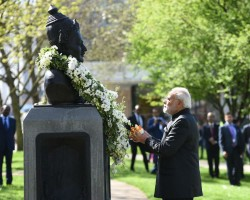 """Prime Minister Narendra Modi pays his floral tribute to 12th century Lingayat philosopher and social reformer Bhagwan Basaveshwara statue on his birth Anniversary at Albert Embankment Gardens on the banks of the river Thames in London. Modi shared a picture on Twitter with the caption, """"It is an honour to pay homage to Bhagwan Basaveshwara during my UK visit. The ideals of Bhagwan Basaveshwara motivate people across the entire world."""""""