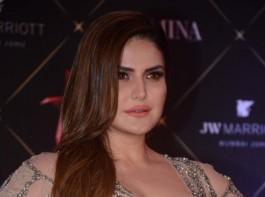 Zareen Khan poses for photographers on her arrival at the Nykaa Femina Beauty Awards 2018