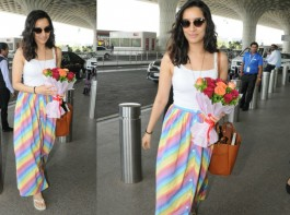 When it comes to style, Bollywood actress Shraddha Kapoor knows how to top the game. Be it a promotional event or a casual outing, the pretty actress brings her A-game every time she steps out. Shraddha was recently snapped by the shutterbugs at the airport wearing a MD Stripes Button front skirt. Keeping it cool and casual at the airport the actress nailed the airport look.