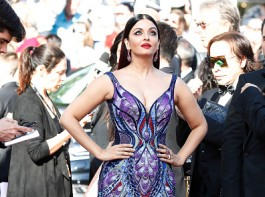 Bollywood Actress and former beauty queen Aishwarya Rai Bachchan made a colourful statement with a dramatic 'butterfly' gown by Dubai-based designer Michael Cinco for her first red carpet appearance at the 71st Cannes Film Festival here on Saturday. Aishwarya, who clocks her 17th year at the film jamboree this time as L'Oreal Paris brand ambassador, took a confident walk with the exquisite three meter train trailing behind and catching the attention of the crowd. She walked the red carpet for the premiere of Eva Husson's French drama