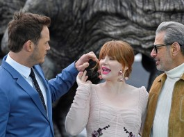 Cast members (L to R) Chris Pratt, Bryce Dallas Howard, and Jeff Goldblum pose in front of a model dinosaur during a photocall to promote the forthcoming film 'Jurassic World: Fallen Kingdom' in London, Britain, May 24, 2018. Universal Pictures India's