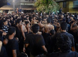 Shiite Muslim mourners beat their chest during a flagellation ritual