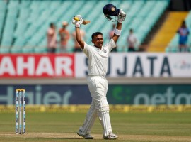 The debutant brings up his maiden Test half-century from 56 balls