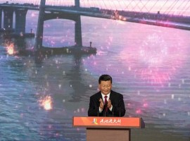 Chinese President Xi Jinping launches the world's longest sea-bridge