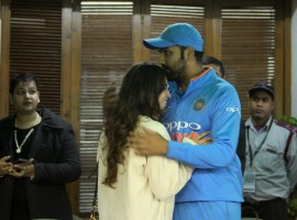 Indian cricketer Rohit Sharma with his wife Ritika Sajdeh after he became the first cricketer to score three double hundred in the One-Day International (ODI), at Punjab Cricket Association IS Bindra Stadium in Mohali.