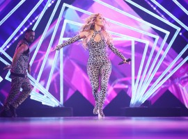 Singer-actress Jennifer Lopez, who went through eight costume changes for a pre-Super Bowl concert in Minneapolis, grabbed eyeballs with her famous curves in a skin-tight leopard-print catsuit.