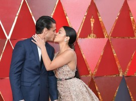 Joe LoCicero (L) and Gina Rodriguez attend the 90th Annual Academy Awards at Hollywood & Highland Center on March 4, 2018 in Hollywood, California.