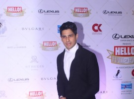 Sidharth Malhotra poses for the cameras on his arrival at the Hello Hall of Fame Awards 2018 .