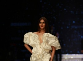 Actress Vaani Kapoor walks the ramp in fashion designers Ashish N Soni and Gauri and Nainika's creation at Amazon India Fashion Week in New Delhi, on March 14, 2018.