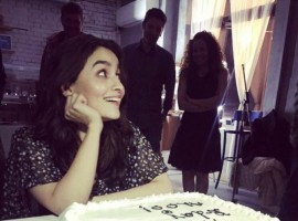 Alia Bhatt posing with her birthday cake and it is really cute.