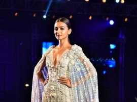 Taking the ramp by storm in a Manish Malhotra creation for the first time, She gracefully carried herself in a white sheer chiffon Grecian gown with embroidery of flowers and a trail. She re defined elegance.