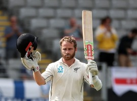 New Zealand's captain Kane Williamson celebrates his century during the second day of the day-night Test cricket match between New Zealand and England at Eden Park in Auckland on March 23, 2018.