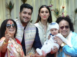 Music composer Bappi Lahiri along with his wife Chitrani, son Bappa Lahiri and daughter-in-law Tanisha during the rice ceremony (annaprasanna) of his grandson, in Mumbai.