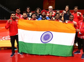 India clinched a historic gold in men's table tennis, thrashing Nigeria 3-0 in the final of the event at the 21st Commonwealth Games here on Monday. After beating Singapore in the semi-finals earlier on Monday, the Indian team continued their dominance in the final, by winning all the first three matches to comfortably clinch the gold. Seasoned paddler Achanta Sharath Kamal gave India an early 1-0 lead with a thumping 4-11, 11-5, 11-4, 11-9 comeback win over Bode Abiodun in the first singles match of the contest.
