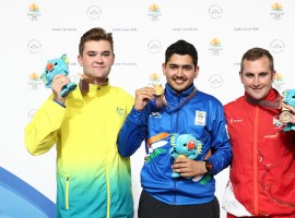 Silver medalist Sergei Evglevski of Australia, gold medalist Anish of India and bronze medalist Sam Gowin of England pose during the medal ceremony for the 25m Rapid Fire Pistol Men's Finals during the Shooting on day nine of the Gold Coast 2018 Commonwealth Games at Belmont Shooting Centre on April 13, 2018 on the Brisbane, Australia.