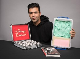 Filmmaker Karan Johar says he feels honoured to be the first filmmaker from India to have a wax statue at the Madame Tussauds. Karan on Thursday tweeted a photograph of himself, holding a briefcase in one hand and a wax imprint of his palm on the other hand. A copy of his biography