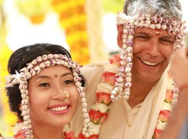 The 52-yr-old actor-model Milind Soman has entered wedlock with his longtime girlfriend Ankita Konwar in a simple Maharashtrian tradition in Alibag, Mumbai on April 22. The couple took their wedding vows in the presence of their friends and family. Their friends shared several pics from the wedding on social media. Check out these pics from their wedding ceremony.