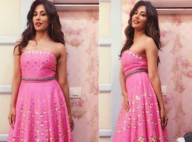 Bollywood film actress Chitrangda Singh looked stunning in a long pink dress which she wore for the dance reality show. There was an Indian touch given to her western outfit with the beaded flower work done on it. It was a Pap Dont Preach creation which had a small belt around the waist accentuating her figure. She kept the look completely simple just wore ring earrings. Her open hair complimented her simple yet sexy attire.