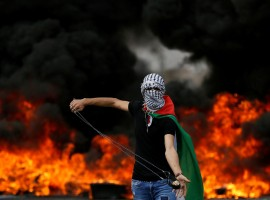 Clashes between Palestinians and Israeli forces break out during the 70th anniversary of Nakba, when hundreds of thousands fled or were driven from their homes in violence culminating in war between the newly created Jewish state and its Arab neighbors in 1948. A Palestinian demonstrator holds a sling during a protest marking the 70th anniversary of Nakba, near the Jewish settlement of Beit El, near Ramallah, in the occupied West Bank May 15, 2018.