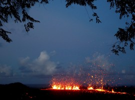 Lava erupts from a fissure on the outskirts of Pahoa during ongoing eruptions of the Kilauea Volcano in Hawaii, U.S., May 14, 2018. Governor David Ige has asked President Donald Trump to issue a disaster declaration for Hawaii as a result of the ongoing earthquakes and volcano eruption, according to a press release. The declaration allows federal funds to begin to flow to state and local efforts in Hawaii. The Kilauea eruption last week created new volcanic vents on the ground miles east of the summit, releasing slow-moving lava and toxic gas into island communities.