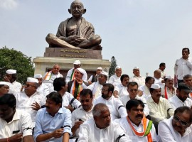 The beleaguered Congress and Janata Dal-Secular (JD-S) leaders on Thursday staged a protest against BJP leader B.S. Yeddyurappa's swearing-in as the Karnataka Chief Minister, terming it unconstitutional. Leaders of the Congress and JD-S, who had hastily stitched a post-poll alliance, staged the protest in front of the state legislature building soon after Yeddyurappa was administered the oath of office by Governor Vajubhai R. Vala at the Raj Bhavan.