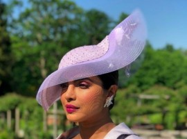 Internationally acclaimed Indian actress Priyanka Chopra, who made heads turn with her chic lilac dress suit at actress Meghan Markle and Prince Harry's wedding on Saturday, says the day will be remembered as it stood for change and hope. Taking to Instagram with an image of the newly married royal couple, who can be seen coming out of the chapel after exchanging their vows, Priyanka wrote an emotional note conveying her love and belief in the marriage. She wrote: