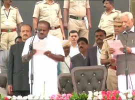 H.D. Kumaraswamy was on Wednesday sworn in as the Chief Minister of a Janata Dal-Secular-Congress coalition government in Karnataka. Governor Vajubhai Vala administered the oath of office to Kumaraswamy, the state's 25th Chief Minister, at 4.30 p.m. on the grand steps of the state Secretariat in the presence of national and regional leaders from across the country. Among the prominent political leaders present on the huge dais were UPA Chairperson Sonia Gandhi, Congress President Rahul Gandhi, BSP supremo Mayawati, Samajwadi Party President Akhilesh Yadav, expelled Janata Dal-United President Sharad Yadav and Communist Party of India-Marxist General Secretary Sitaram Yechury. Chief Ministers Mamata Bannerjee (West Bengal), N. Chandrababu Naidu (Andhra Pradesh) and Pinarayi Vijayan (Kerala) were also present at the 10-minute swearing-in ceremony. Thousands of JD-S and Congress cadres and supporters from across the state, especially the Mysuru region thronged the venue braving the rain.