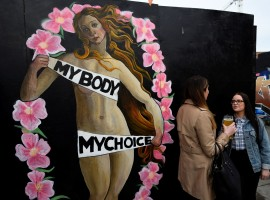 An upcoming vote on whether to scrap the 1983 ban on abortion is the latest referendum to gauge just how much has changed in Ireland, once one of Europe's most socially conservative and staunchly Catholic countries. Women chat in front of a Pro-Choice mural ahead of a 25th May referendum on abortion law, in Dublin, Ireland.