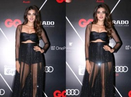 Bollywood's gen next actress Nidhhi Agerwal grabbed eyeballs at the GQ Best Dressed party on Saturday night. The actress made her debut with Tiger Shroff in the dance film and made a mark in the industry with her talent. Dressed in black mesh separates, Nidhhi Agerwal kept it simple with no accessories. The actress, who is usually seen in comfort casuals made a style statement as she dressed to perfection in the black outfit. Nidhhi looked smoking hot in black with the sheer outfit accentuating her curvaceous body. One of the fittest actresses in Bollywood, Niddhi Agerwal gives her fans an insight into her life with her carefree gym looks. Nidhhi is quite active on social media and keeps sharing insights into her life through her posts. Sharing pictures of her sultry photoshoots, the young actress sets the mercury rising with her oozing hotness. The girl next door who does not hail from the film industry has made it on her own and finds her roots in Banglore just like Deepika Padukone and Anushka Sharma.