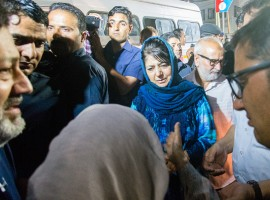 Mehbooba Mufti Chief Minister of Jammu and Kashmir consoles the mother of Syed Shujaat Bukhari, the editor of Rising Kashmir daily newspaper, killed by unidentified gunmen outside his office on June 14, 2018 in Srinagar, the summer capital of Indian administered Kashmir, India. Shujaat Bukhari editor of Rising Kashmir a leading newspaper, journalist has been shot dead along with his two security guards, by unidentified gunmen in Srinagar. Bukhari, was attacked in his car near the office of the Rising Kashmir newspaper. No group has claimed the killings but Indian police say militants are suspected to have carried out the attack. He was in his early 50s and is survived by his wife, son, daughter and parents. Kashmiri journalists have been the targets of both Militants and Indian government forces, and at least dozen have been killed and many wounded since the revolt against Indian rule in 1989.