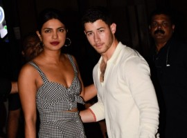 Actress Priyanka Chopra, who has brought her rumoured boyfriend Nick Jonas to India, stepped out for a dinner date with the US-based singer here on Friday. In some photographs surfaced online, the duo can be seen walking hand-in-hand during their low-key outing. While Priyanka opted for a black-and-white checkered dress for the outing, Nick, on the other hand, looked pretty relaxed as he walked next to Priyanka donning a white shirt and khakhee pants. Priyanka and Nick, who have been romantically linked to each other ever since 2017 MET Gala, where they walked the red carpet together in Ralph Lauren designs, landed in India on Thursday night.