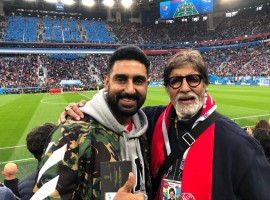 B-town's coolest father-son duo, Amitabh Bachchan, and Abhishek Bachchan, who are currently holidaying in Russia, headed to catch the first semi-finals of the ongoing 21st edition of the FIFA World Cup 2018. Junior Bachchan is a well-known football enthusiast and even owns a club in an Indian League. However, it seems that senior Bachchan has joined his son's interests. Taking to his social media handle, the 'Housefull 3' star posted a snap of himself and his father holding the tickets for the semi-final clash between France and Belgium at the Saint Petersburg Stadium. In the post, Junior Bachchan also congratulated France for entering the finals of the prestigious tournament following their 1-0 win over Belgium. He wrote,