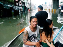 Residents are transported on a canoe along a flooded street caused by monsoon rains and Tropical Storm Son-Tinh in Quezon city, Metro Manila, in Philippines July 17, 2018.