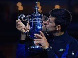 Novak Djokovic of Serbia poses with championship trophy after winning