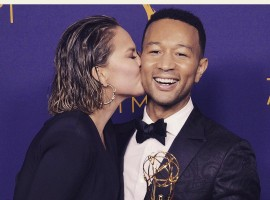 Chrissy Teigen shares a passionate kiss with John Legend