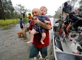 Oliver Kelly, 1 year old, cries as he is carried off the sheriff's airboat